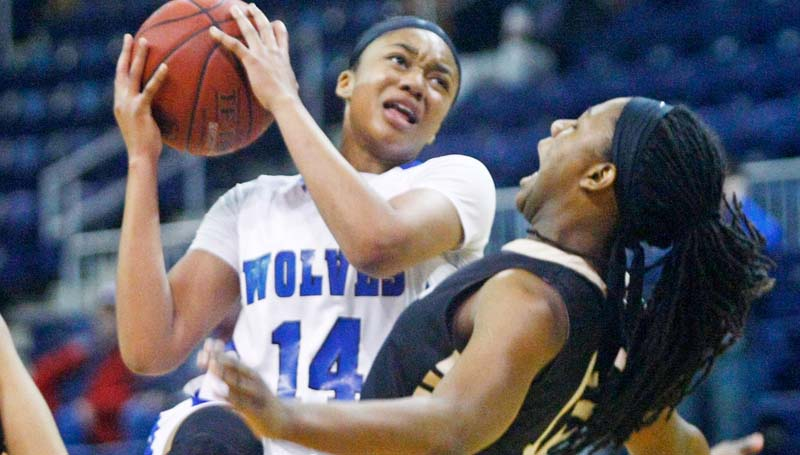 Co-Lin Media / Natalie Davis / Co-Lin Tytiana Hall (14) goes up for the shot guarded by East Central's Jelisa Pearson (15).