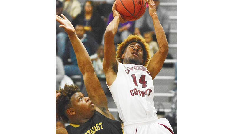 Daily Leader / Scott Boyd / Lawrence County's Gabe Lewis drives to the basket in Wednesday night's win over Northeast Jones in the 4A South State playoffs at Monticello.