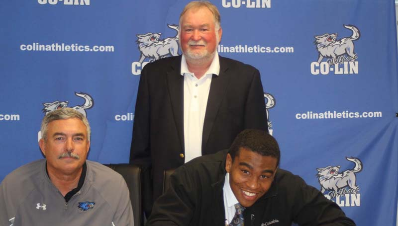Co-Lin Media / Natalie Davis / Copiah-Lincoln Community College linebacker Marico Paige of Walls (Wesson) has signed with the Murray State University Racers. Paige (6-2, 225), who prepped at Lake Cormorant High School, with tied for second on the team with 47 tackles, 2 sacks, 2 tackles for loss, 2 forced fumbles, and 1 fumble recovery this season. He was named Mississippi Association of Community and Junior College Second Team All-State. Pictured with Paige are Co-Lin head coach Glenn Davis (seated left) and Tony McInnis of Wesson (standing). The Wolfpack finished the 2015 season ranked No. 4 in the NJCAA poll.