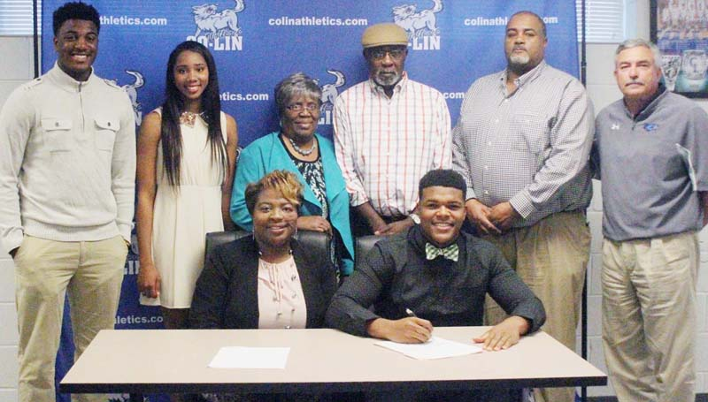 Co-Lin Media / Natalie Davis / Copiah-Lincoln Community College linebacker Zach Williams of Lena (seated right) has signed with the University of Alabama Birmingham Blazers. Williams (6-2, 240), who prepped at Leake County High School, accounted for 36 tackles this season, 2 sacks, 7 tackles for loss and 1 interception. He was named College Sports Information Directors of America (CoSIDA) Academic All-District 1 First Team this season and MACJC Second Team All-State his freshman year. Pictured with Williams are Lucretia Williams (seated left), standing from left, Brandon Williams, Myia Evans, Laneice Kennedy, John Kennedy, Micheal Williams, and Co-Lin head coach Glenn Davis. The Wolfpack finished the 2015 season ranked No. 4 in the NJCAA poll.