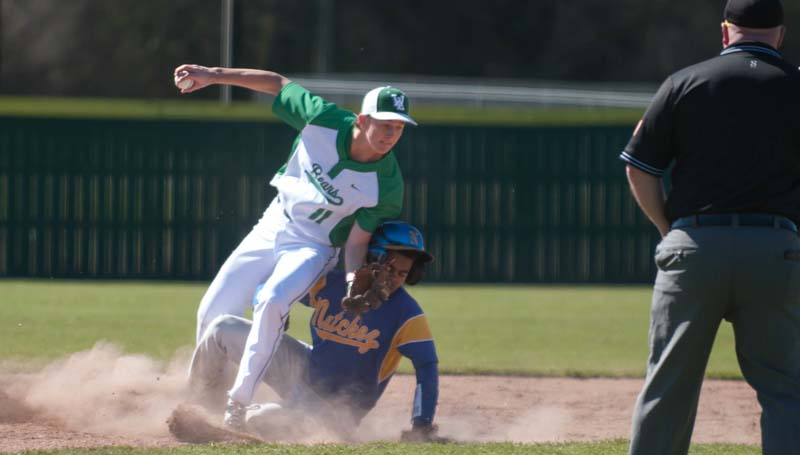 Daily Leader / Teresa Allred / West Lincoln's Nathaniel Addison (11) tags out a Natchez runner trying to steal second base Saturday.