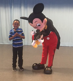 Photo submitted / Dominick Fields gets his stuffed Mickey Mouse signed by the mouse himself during his recent trip to Walt Disney World. Make-A-Wish provided the trip for Fields, who suffers from sickle cell anemia, and his family recently.