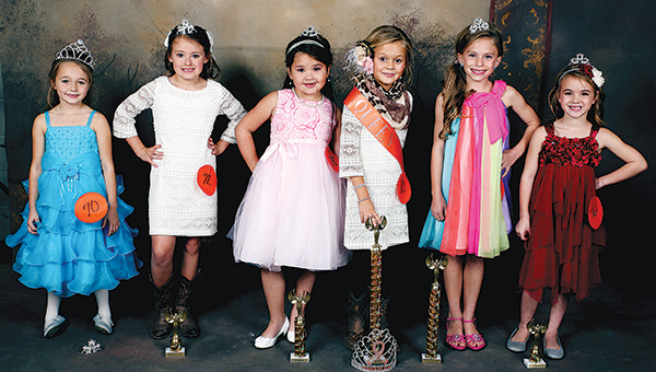 Photos by Amy Rhoads / 7 to 8 years — Nikki Berch, divisional photogenic winner; Emma King, third runner up, Caecillia Smith, second runner up; Kirsten Wade, queen; Savannah Arnold, first runner up; Kamryn Faith Robbins, fourth runner up.