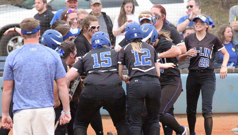 Co-Lin Media / Natalie Davis / Co-Lin's Kaitlyn Taylor is greeted at home plate by her teammates after hitting a 3-run home run Monday against Southwest in JUCO softball action.