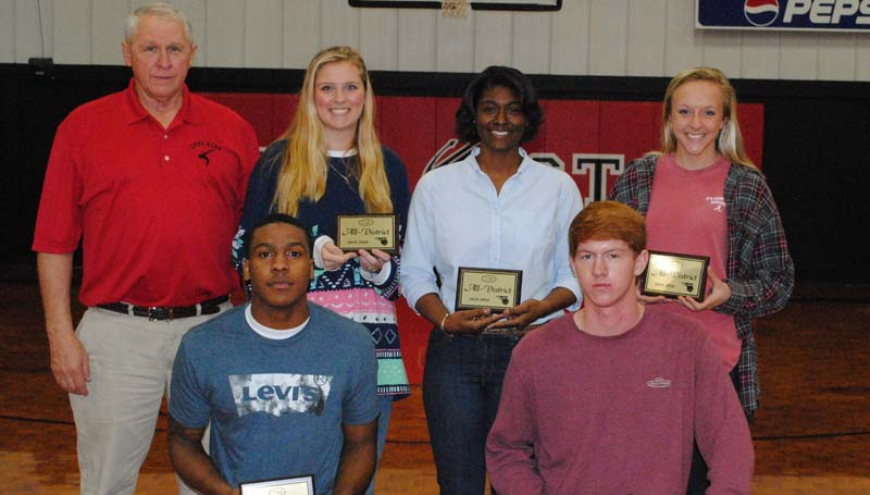 "Daily Leader / Marty Albright Several members of the Loyd Star basketball team received Region 7-2 All-District honors (kneeling, from left) Javion Beard, All-Region; Levi Redd, All-Region (back) Coach Gene ""Moochie"" Britt, All-Region girls coach of the year; Hannah Dickerson, All-Region; Jordan Shelby, All-Region and McKenzie Smith, All-Region Girls Most Valuable Player."