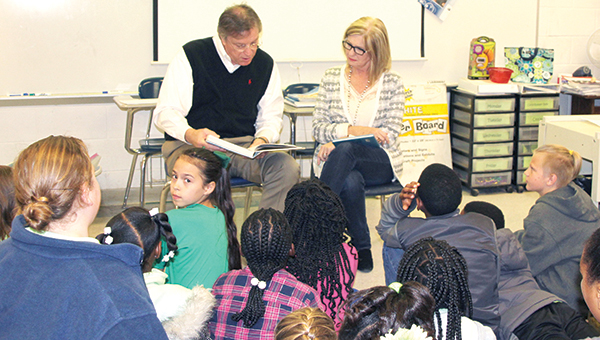 Photo by Alex Jacks / Mayor Joe Cox and his wife, Angie, stop by Brookhaven Elementary School to help celebrate Read Across America Day.