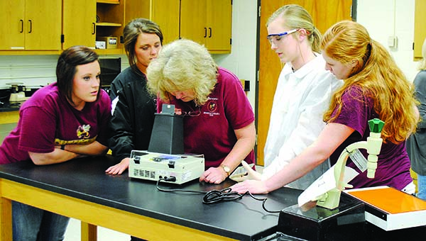 Photo by Aaron Paden / Students from Loyd Star, Enterprise and Natchez Cathedral gather at Co-Lin for an entomology DNA lesson.