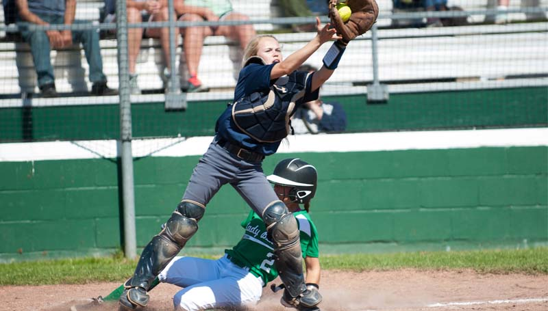 Daily Leader / Teresa Allred / West Lincoln's Sara Jane Doty (2) slides in safely to home plate while Bogue Chitto catcher Kayci Beth Wallace (19) stretches to make the catch in softball action Saturday.