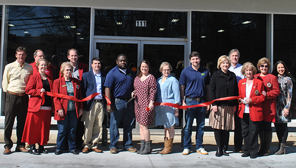 Ribbon Cutting Daily Leader