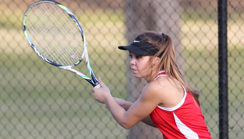 Daily Leader / Katie Furr / Loyd Star's Ashlyn Locke prepares to return a serve in tennis action against West Lincoln Monday at the Brookhaven Country Club.