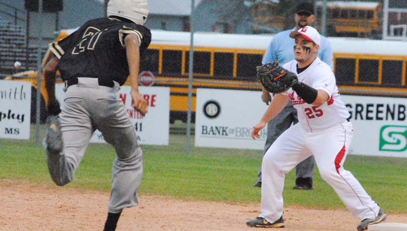 Daily Leader / Marty Albright / Loyd Star's first baseman Bradyn Brister (25) records the out at first base against Bassfield.
