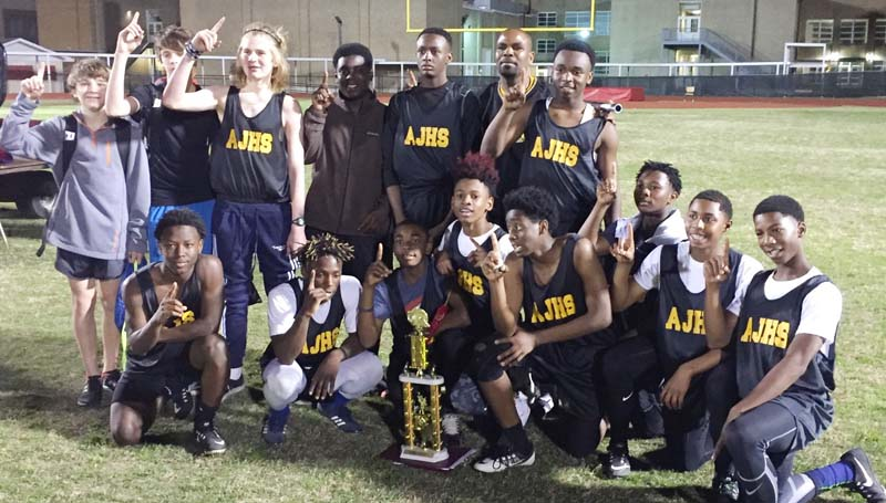 Daily Leader / Photo submitted / The Alexander Junior High boys' track and field team captured first place overall Tuesday as they hosted an invitational at King Field. Members of the team are (kneeling, from left) Toranta Williams, Jamie Finley, Caleb Edwards, Nick Williams, Kadavieun Hunter, JaQuarius Edwards, Quintaye Bates, and Gabrielle Burnett, (standing) Jacob Britt, Ethan Autrey, Samuel Mabile, Hurriah Lawerance, Piedro Wilson, Coach Alonzo Cameron and Jeremiah James.