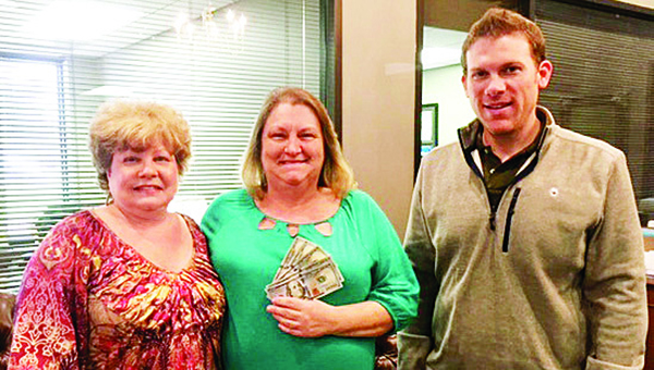"Photo submitted / Gail Thompson Kyzar of Bogue Chitto won $500 cash in First Bank's ""Win the Benjamins"" Facebook Contest. Kyzar said, ""My husband has been laid off from his job for quite a few months due to the economy and only recently went back to work. This is such a blessing."" She is pictured (center) with Brookhaven Branch Manager Connie Dunn (left) and Relationship Manger Eli Ferguson (right).  The contest, sponsored on First Bank's Facebook page, began in mid-February and ended on President's Day. To comply with Facebook rules, participants were eligible by ""liking"" the First Bank page and commenting on a recent post. The winner was then chosen by random drawing. Both customers and non-customers, 18 and over, could enter the ""Win the Benjamins"" contest."