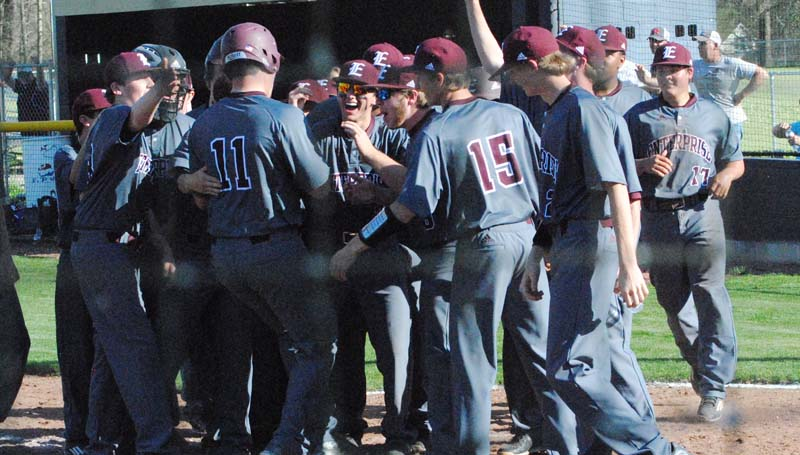 Daily Leader / Marty Albright / Enterprise's Hunter Richardson is greeted at home plate by his teammates after hitting a homerun against Bogue Chitto Monday.