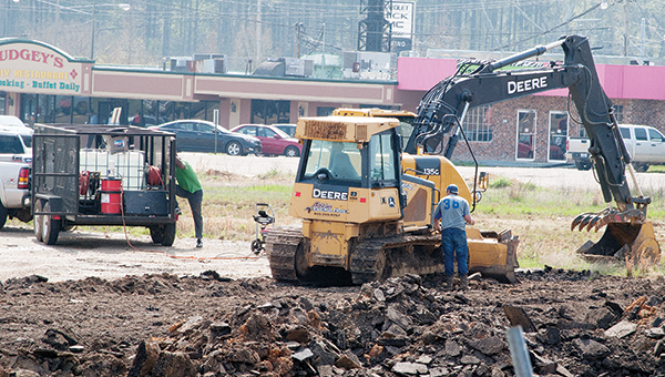 Photo by Aaron Paden / Workers are clearing the vacant lot near the intersection of Hwy. 51 and Brookway Boulevard for the new location of Jeff Wilson Chrysler Dodge Jeep Ram.