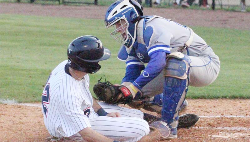 Co-Lin Media / Natalie Davis / Co-Lin catcher J.T. Wright tags out Southwest's John Marcus McDowell at home.