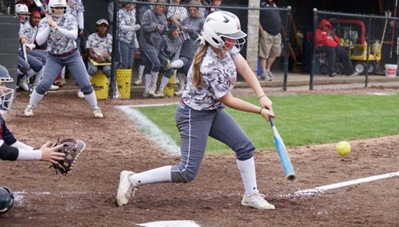 Daily Leader / Jana Harp / Lawrence County's Sydney Pevey (8) provides a big hit against Brookhaven Saturday. She finished with a double and a single.