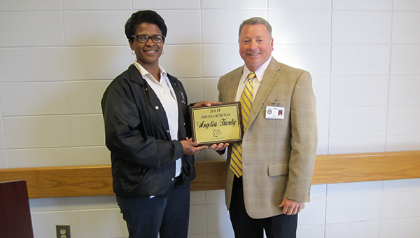 "Photo submitted / Angelia Hardy (left) was named Mississippi Adolescent Center's Employee of the Year for 2015 during the annual Employee of the Year Recognition banquet held recently. Facility Director William Gates (right) made the announcement during the awards portion of the program. Gates said,  ""Angie"" works in the education department and was a dedicated employee and very deserving of the honor.  She was presented with a plaque for her great service."