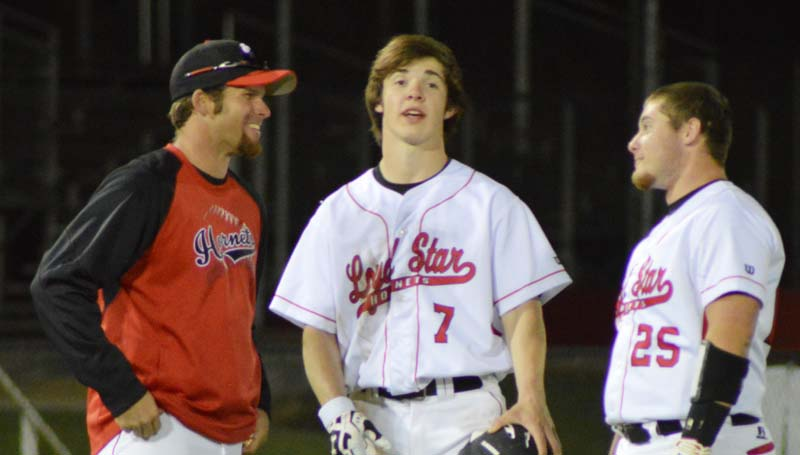 Daily Leader / Chris King / Loyd Star coach Jared Britt (left) gives instructions to juniors Parker Flowers (7) and Bradyn Brister (25) during a pitching change for Terry.