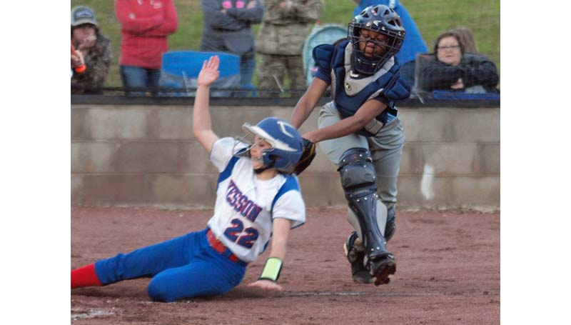 Daily Leader / Tracy Fischer / Port Gibson's catcher DeUndra Nichols fails to make the tag in time at home plate as Wesson's runner Arie Douglas scores safely in Monday action.