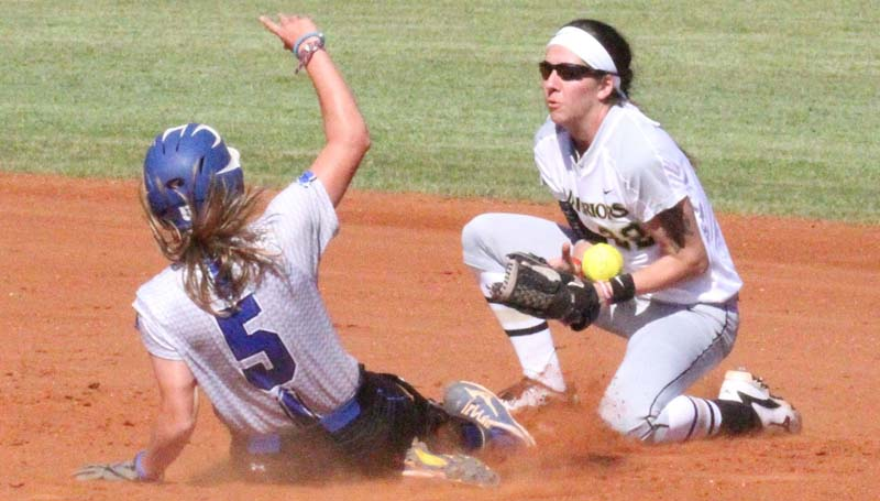 Co-Lin Media / Natalie Davis / Co-Lin's Mackenzie Byrd (5) slides safely into second base as East Central's Katlyn Duke bobbles the throw.