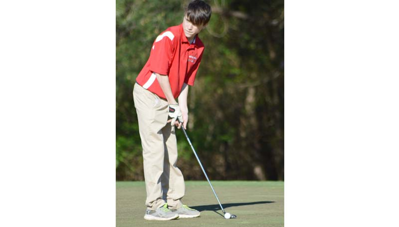 Daily Leader / Chris King / Loyd Star's freshman Jacob Case prepares to make a putt against Wesson.