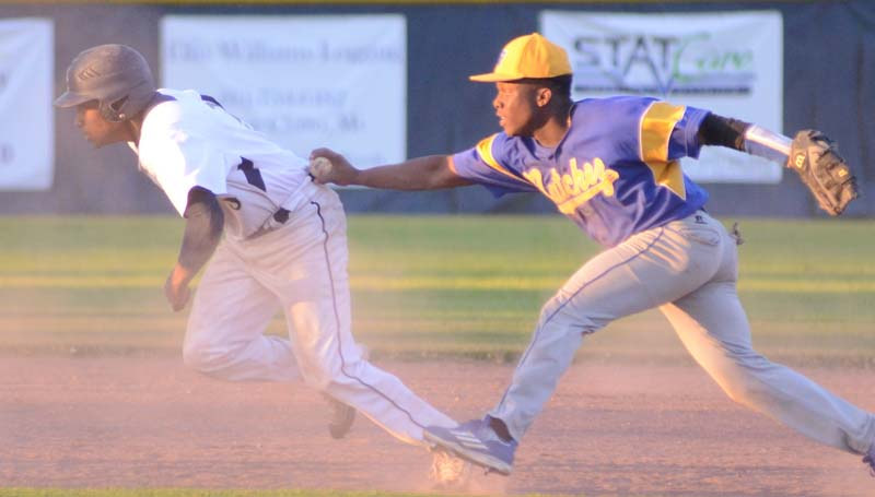 Daily Leader / Marty Albright / Bogue Chitto's Tyler Brumfield (left) gets caught in a run down by Natchez's Tydarius Terrell in baseball action Friday night.