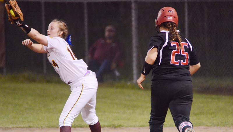 Daily Leader / Marty Albright / Enterprise first baseman Kinsey Dahlin stretches to record the out at first base before Loyd Star's runner Ali Gartman could reach.