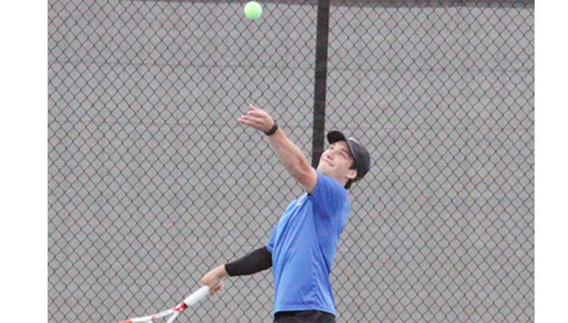 Co-Lin Media / Natalie Davis / Co-Lin's Will Pennington prepares to make a serve to Meridian in men's juco tennis action.