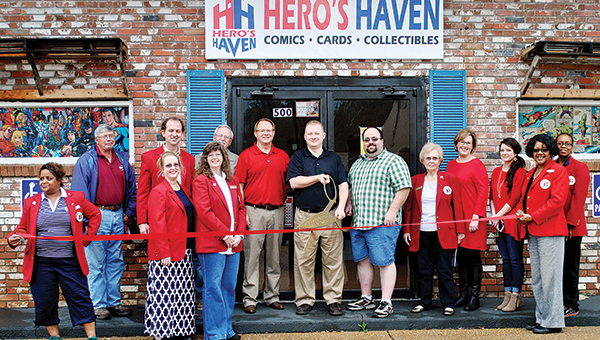 Photo by Kristi Carney / Hero's Haven recently held its ribbon cutting. Personnel of the comics, cards and collectibles store located on Congress Street are Ken Powell, Charles Morris and Jason Reeves.