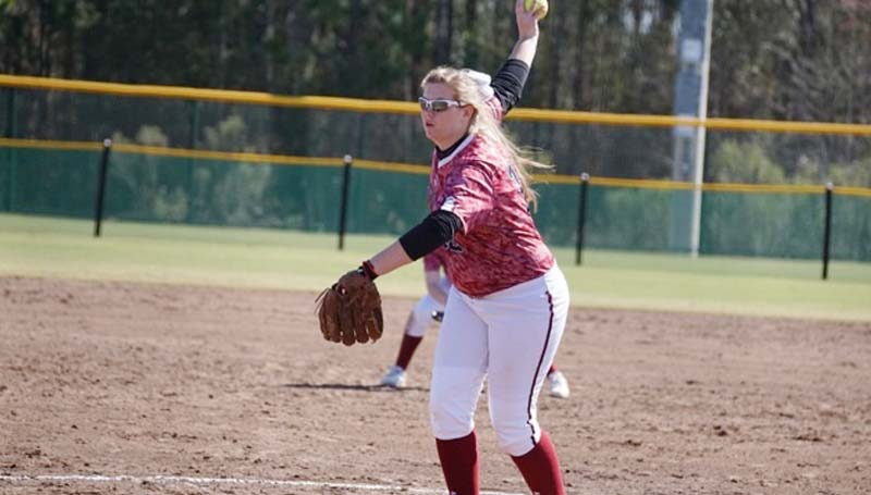 Daily Leader / Jana Harp / Lawrence County's Jordan Harp (12) pitches a perfect game against Raymond in district play.