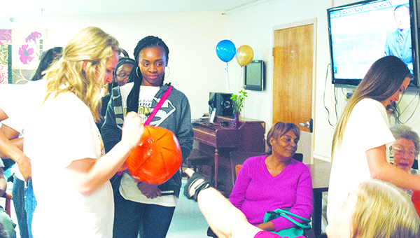 Photo by Aaron Paden / The Bogue Chitto Lady Cats basketball team visited Countrybrook Living Center Monday to celebrate its recent state championship. The team signed balls for residents and gathered for a group photo. The team is scheduled to visit the state Legislature Wednesday.