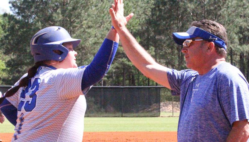 Co-Lin Media / Natalie Davis / Co-Lin catcher Jessica Crum gets a high-five from Lady Wolves head coach Allen Kent after hitting her nation leading 17th home run of the season. Co-Lin thumped Coahoma 16-0 in Game One and 17-0 in Game Two Saturday.