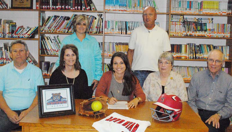 Daily Leader / Marty Albright / Loyd Star outfielder Madison Jones has signed a letter of intent to play softball for the Southwest Community College Lady Bears next year. Pictured with Jones are (from left) father Stan Jones, mother Debbie Jones and grandparents Dorothy Wheat and Charles Wheat, (standing) Loyd Star coach Jan Delaughter and Loyd Star assistant coach Bo Case.
