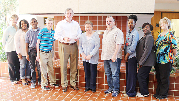 Photo submitted / Boswell Regional Center offers specialized program options to ones with Intellectual and Developmental Disabilities. These programs are designed to identify the necessary supports for successful community transition. Pictured are (from left) Cindy Womack, assistant director; Kimberly Bingham, QIPD at Mississippi Adolescent Center; Larry, service recipient; Aaron, service recipient; Mayor Joe Cox; P. Brown, service recipient; T. Cliburn, service recipient; Stephanie Thompson, health program specialist; Consuela Johnson, QIDP at MAC; and Donna Horton, director of client services at MAC.