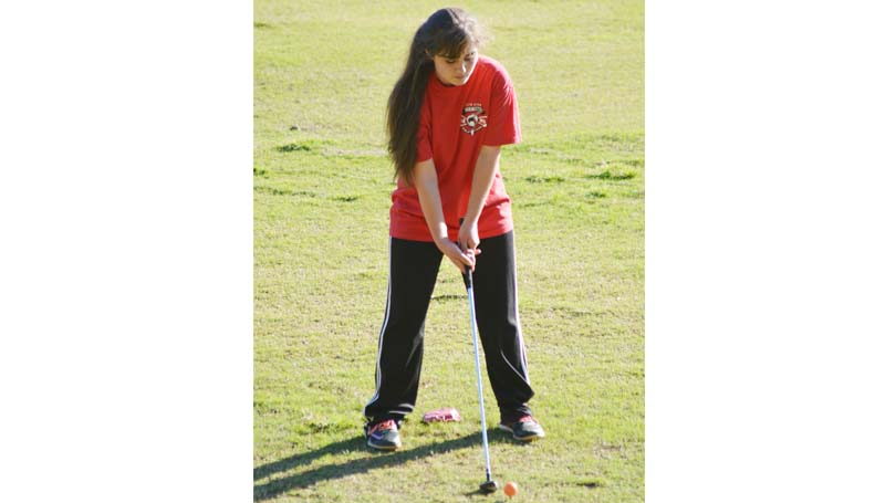 Daily Leader / Chris King / Loyd Star Lady Hornets' medalist Courtney Wyant prepares to drive the ball against Wesson and Prentiss.