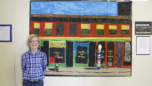 """Photo by Alex Jacks / Seventh grader Sam Allen stands with his reproduction of Edward Hopper's """"Early Sunday Morning."""""""