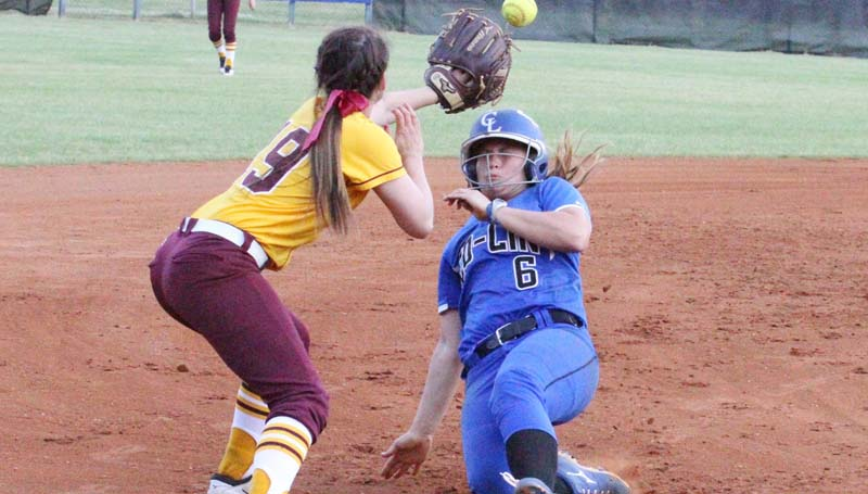 Co-Lin Media / Natalie Davis / Co-Lin's Kaitlyn Taylor slides under the tag of Pearl River third baseman Brooke Barnes.