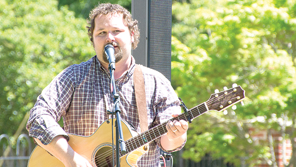 """Photos by Alex Jacks / Tony Norton performs at """"Music and Art at Trinity Park"""" on Thursday at Trinity Park, a rarely-used venue connected to the Church of the Redeemer on 224 West Monticello St.Next week's performance will be at noon Thursday by Andi Cotton and Tyler Bridge."""