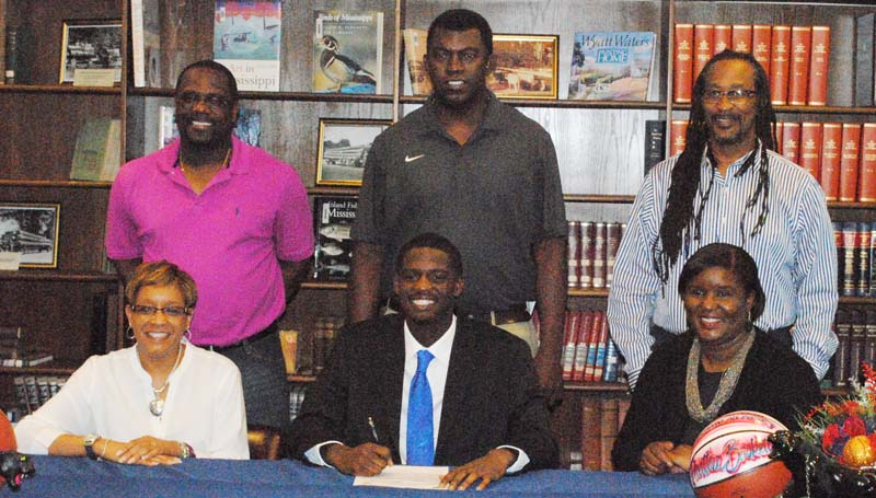 Daily Leader / Marty Albright / Brookhaven's Darrian Wilson has signed a basketball scholarship with the Copiah-Lincoln Community College Wolves. Pictured with Wilson is his step mom Sonya Wilson and mother Betty Wilson-McSwain.  Standing is father/BHS girls coach Preston Wilson, BHS boys basketball coach Jimmie Butler and step father Larry McSwain.