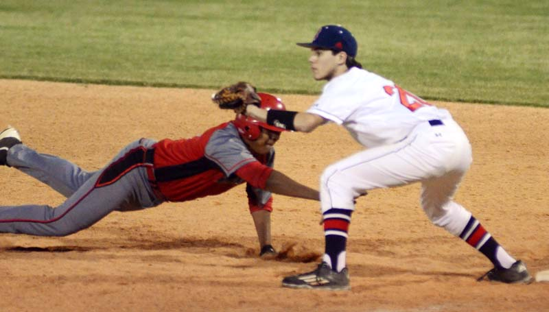 Daily Leader / Marty Albright / Brookhaven first baseman Reese Reynaud prepares to make a tag on Provine's Brandon Taylor diving back to first in Game Two at Moyer Field.
