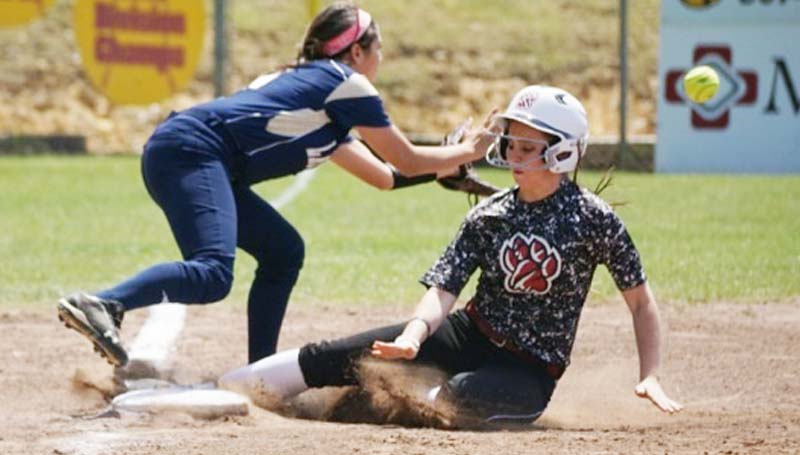 Daily Leader / Jana Harp / Lawrence County's Callie Fortenberry (7) slides in safely at third base against Franklin County on Saturday at Loyd Star.