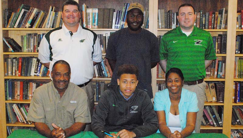 Daily Leader / Marty Albright / West Lincoln's Ronnie Edwards has signed a basketball scholarship to play for the Co-Lin Community College Wolves next year. Pictured with Edwards is (from left) father Lamar Edwards, and mother Angela Edwards. Standing in the back is West Lincoln basketball coach Lane Young (left), brother Bradleigh Brothern and West Lincoln basketball assistant coach Brooks Smith.