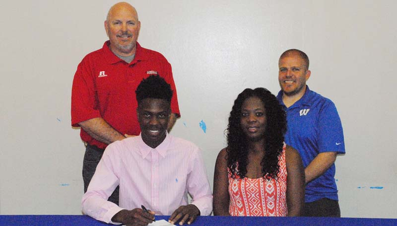 Daily Leader / Marty Albright / Wesson's Anthony Jones signs a basketball scholarship Friday with Co-Lin Community College Wolves. Pictured with Jones is his mother Felicia Butler (right). Standing is Wesson Athletic Director Ronald Greer (left) and Wesson head basketball Coach Rusty Newman.