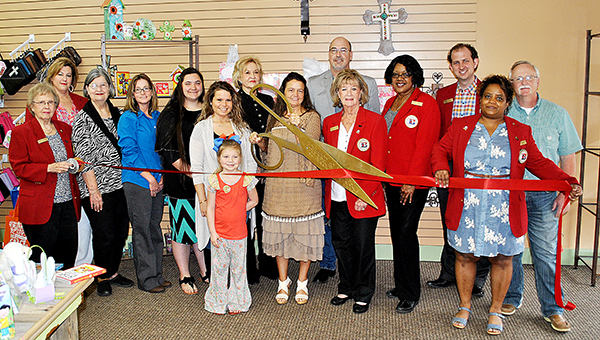 Photo by Kristi Carney / Wooden Cross Book and Gift Shop recently held its ribbon cutting. The store will be open Monday through Saturday 9 a.m. to 5 p.m. and is owned by Deborah and Gary Martin. Her children are Kala Ward and her son Cory and Jonathan and Kayla Martin, and her grandchildren are Andrew Martin, Carey Barnett and Jozalyn Martin.