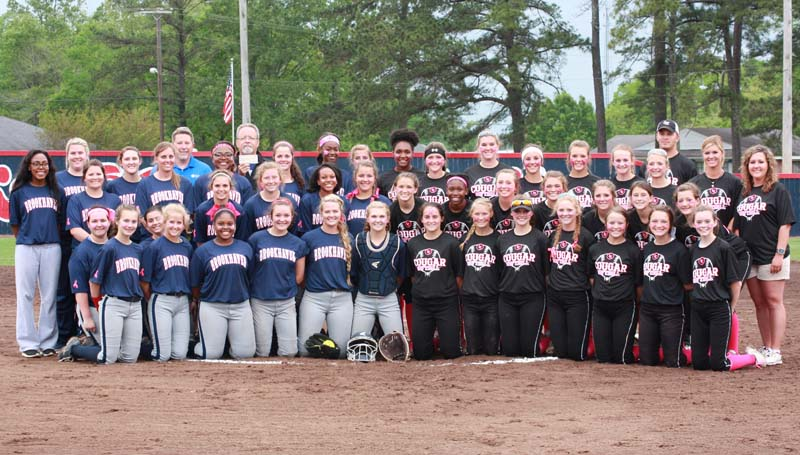 Daily Leader / Photo submitted / The Brookhaven Lady Panthers (left) and the Lawrence County Lady Cougars (right) pose together to recognize breast cancer awareness Tuesday night at the Ole Brook Lady Panthers Softball Complex.