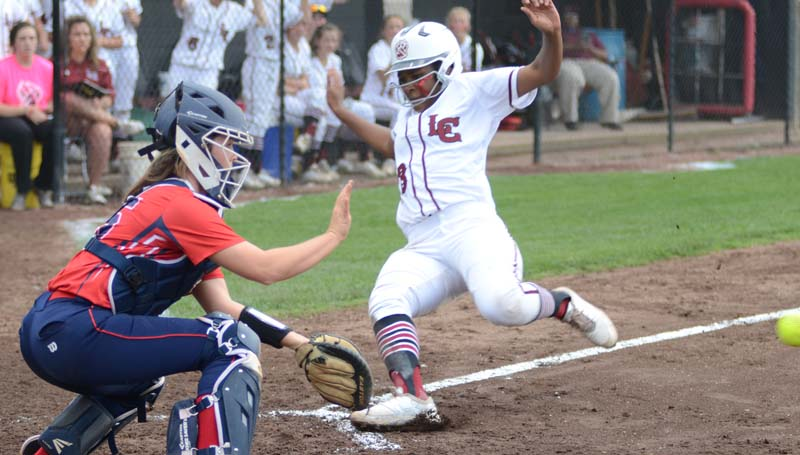 Daily Leader / Marty Albright / Lawrence County's Zyon Feazell slides into home safely as Richton's catcher Hannah Adcock prepares to make the play Thursday night.