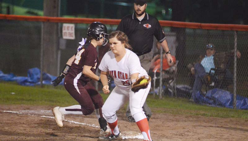 Daily Leader / Marty Albright / Enterprise's Jana Nations hustles back to first base to avoid Ali Gartman's (25) tag Thursday night.