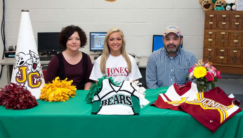 Daily Leader / Teresa Allred / West Lincoln cheerleader Ashlyn Reynaud recently signed a letter of intent to join the Jones Community College cheer team. Pictured with Reynaud is her mother Heather Reynaud (left) and father Keith Reynaud.