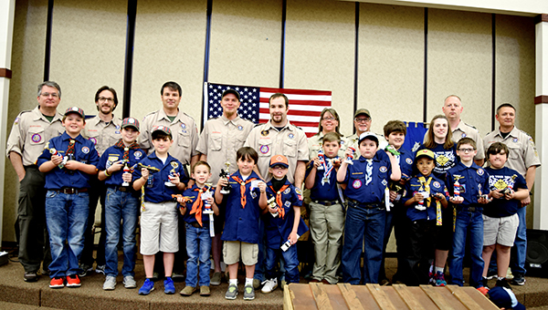 Photos by Julia Miller /  Pack 119's Pinewood Derby was held April 2 and abided by Boy Scouts of America's rules which sets a weight and size limit for each car. The first through third place in each troop received a trophy. The winner of each troop competed for the overall pack title.